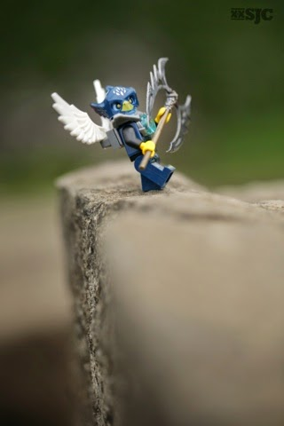 LEGO Chima bird holds custom sterling silver double headed axe on the edge of a cliff
