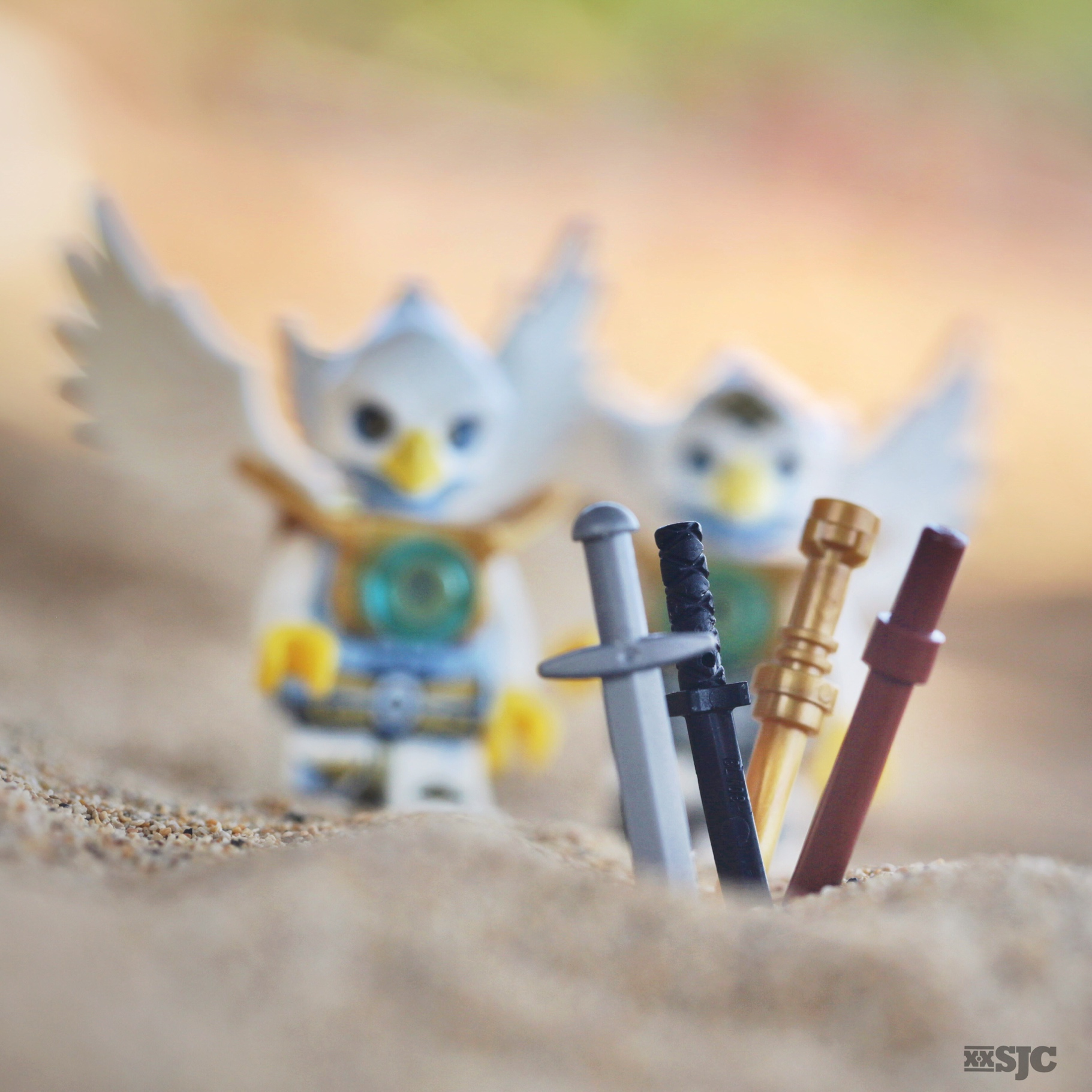 Two Lego Chima birds gather their weapons in preparation for battle, toy photography